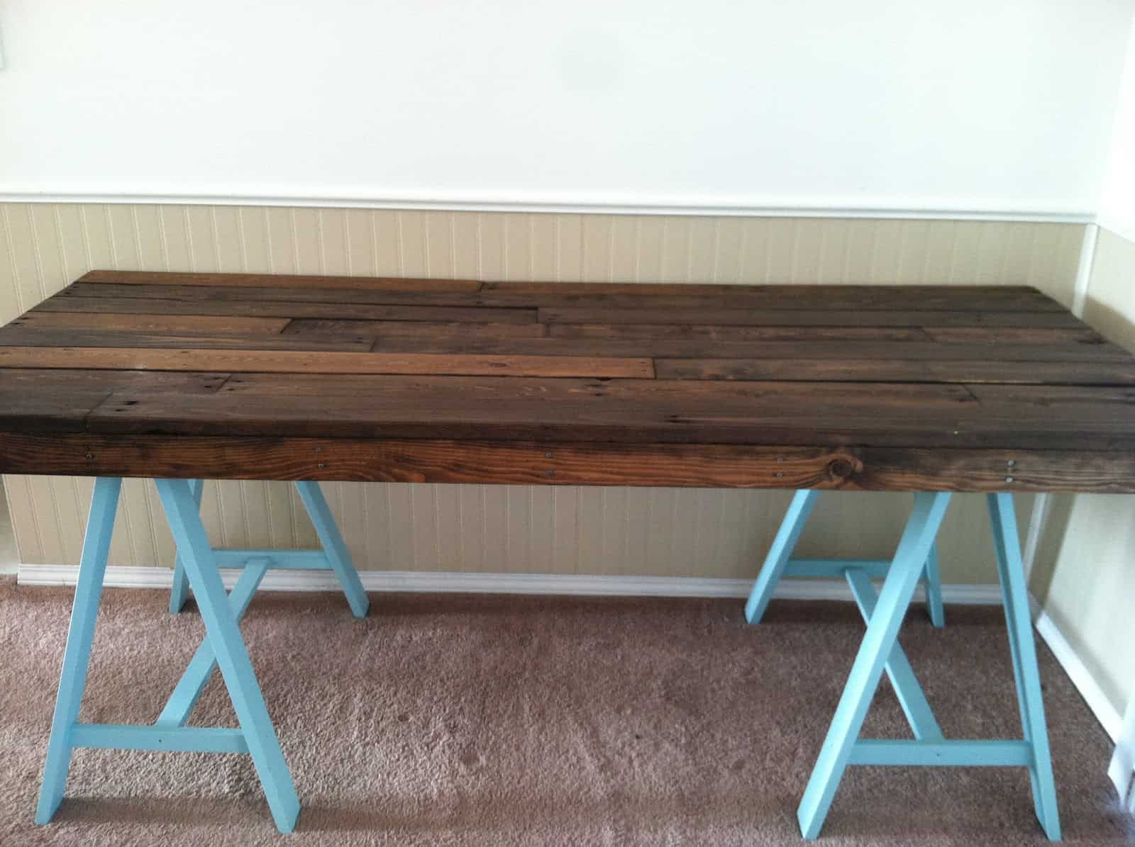 Diy pallet and sawhorse desk tutorial simple stylings Diy work desk