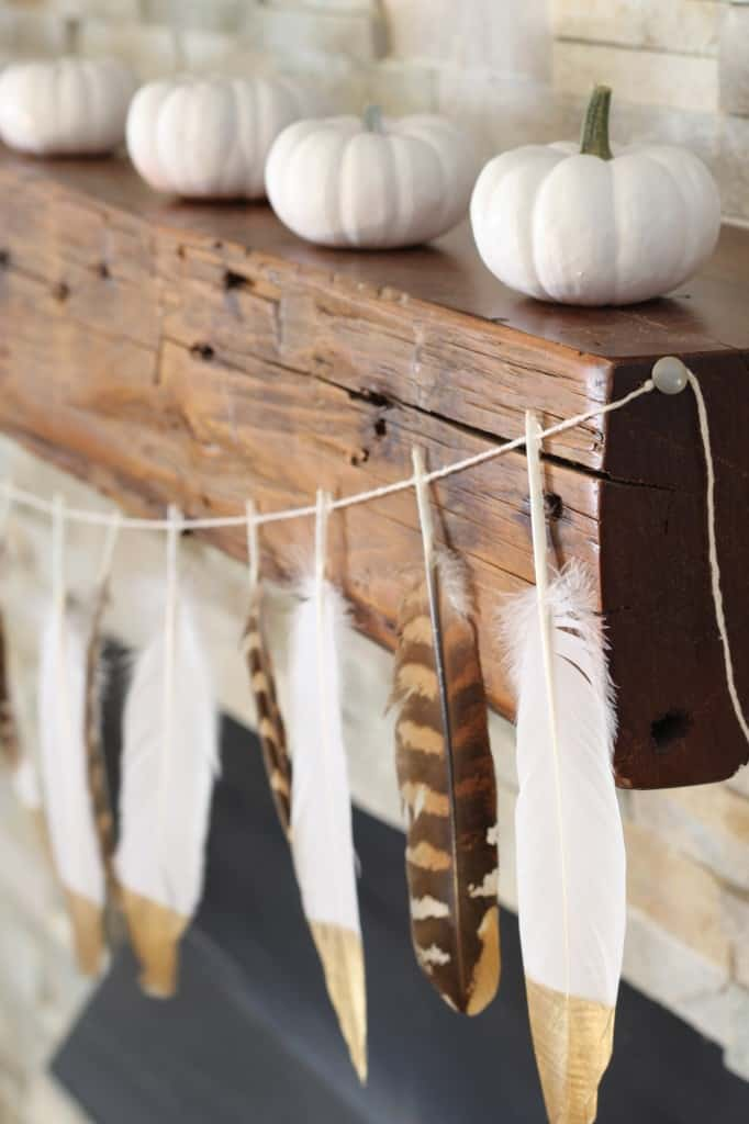 http://simplestylings.com/diy-gold-tip-feather-garland/
