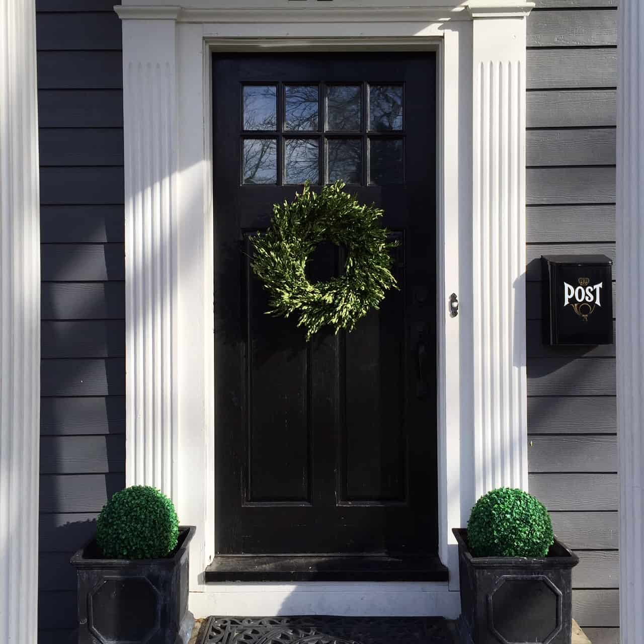 Glossy Black Front Door, Flanked With Simple Sleek