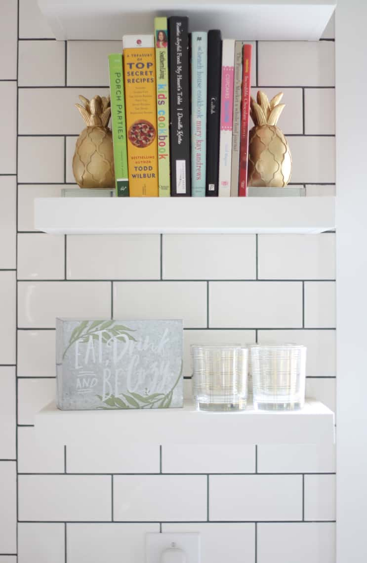 Small eat, drink and be cozy, metal sign on open shelves in kitchen