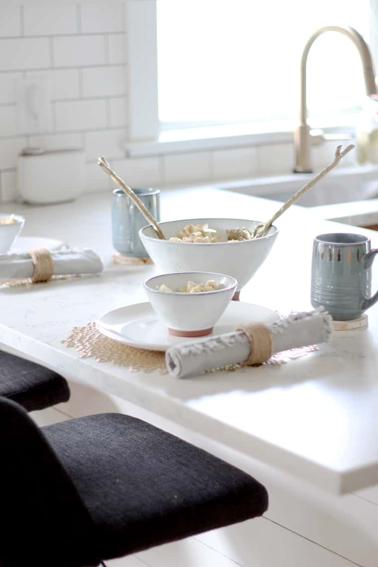 cozy fall place settings at bar with bowls of potato salad
