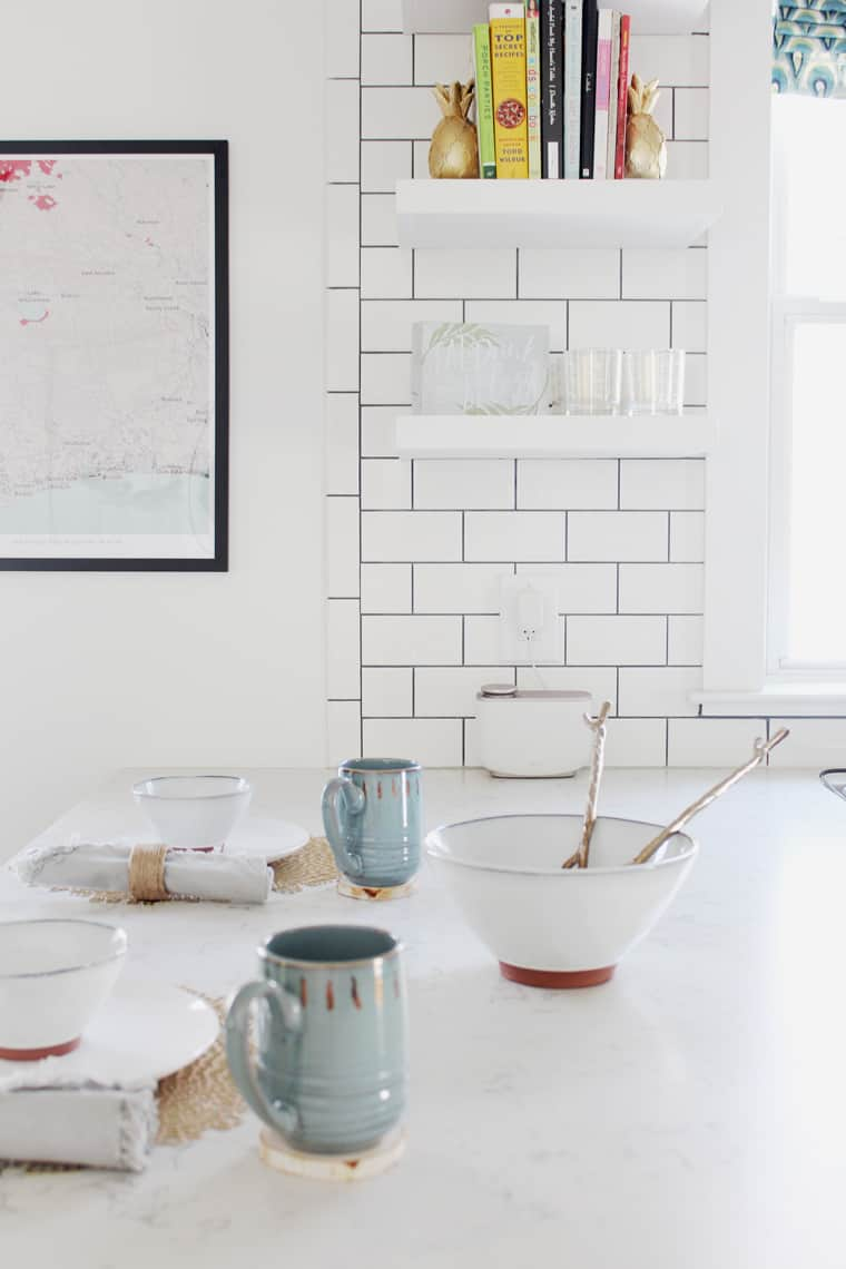 Cozy Fall Decorating Ideas with place setting on a counter peninsula in our white kitchen